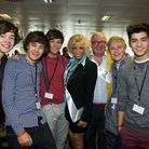 One Direction posing with two patrons of the Lowe Syndrome Trust - Christopher Biggins and Lisa Voic