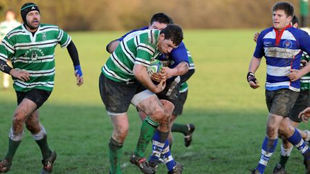 Hendon's Paul Geraghty (centre) in action
