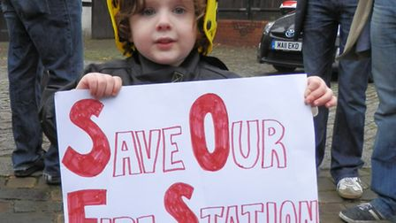 A young campaigner outside Belsize fire station, which is proposed for closure