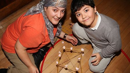 Mother Gulsen Alagoz and son Atakan,seven, build up an spaguetti tower at the Science Day in Tyssen