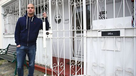 Bradley Robeiro, 29, stands next to the gates that are set to be removed