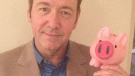 Kevin Spacey pictured with a Pigs4Kids campaign piggy bank.