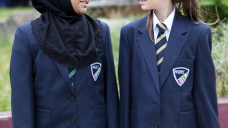 Pupils at Regent High School model the new uniform and logo.