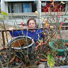 Mrs Elshamy with her plants that are now in a caged cart outside her flat in Sandstone Place N19.