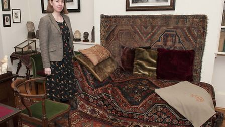 Freud Musuem development director Marion Stone with the psychoanalyst's famous couch. Picture: Nigel