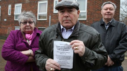 Blackstone Estate residents John Hunt, his wife Florence and Cliff Gully,right, stand up with a peti
