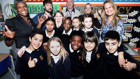 New Executive Headteacher Sarah Bailey, right, celebrates the good report with children and teachers