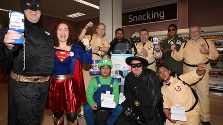A Tesco staff fundraising group in Morning Lane, Hackney, collect money to beat cancer.