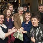 Tom Conti (centre) draws the Hampstead Christmas Crawl prize at The Flask pub. Picture: Nigel Sutton