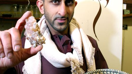 Shebhaz Khan showing off raw frankincense from Oman on sale at the store. Picture: Polly Hancock.