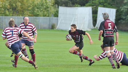UCS Old Boys' Aled Davies (centre) in action