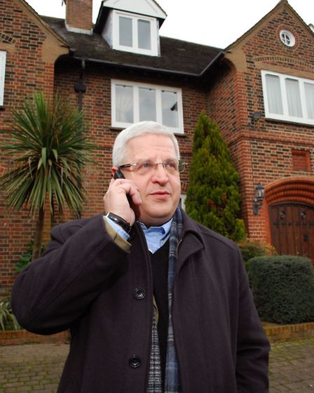 Grant Alexson, head of Knight Frank in Hampstead, outside a property for sale on The Bishops Avenue.