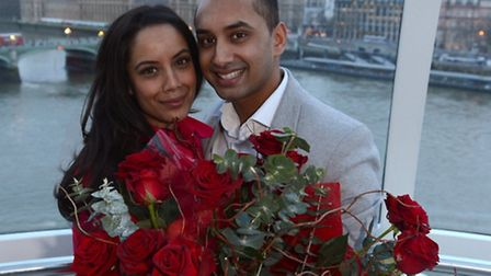 Natasha and Jagan celebrate after their engagement in a capsule on the London Eye