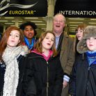 Members of the New London Children's Choir with musical director Ronald Corp leaving St Pancras Inte
