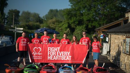 Adam (far left) with fellow kayakers in Lechlade before setting off down the Thames. Photo: Dorin Va