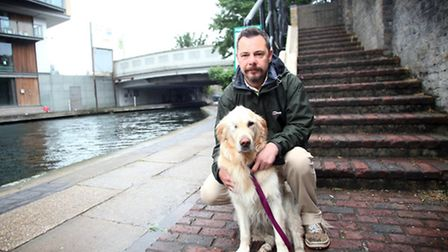 Chris O'Leary and his golden retriever Cassie. Mr O'Leary is upset about the council's dog control o