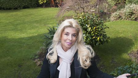 Property magnate Debbie Dove in the garden where Peter Sellers and Elizabeth Taylor once partied. Pi