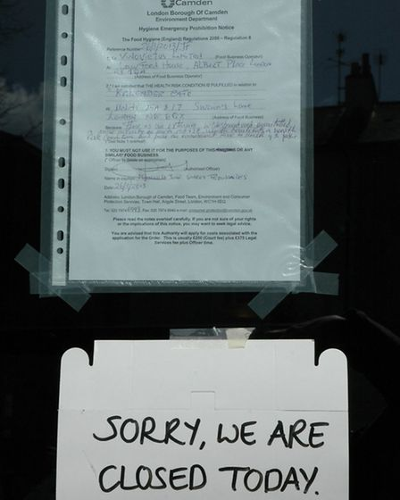 The 'hygiene emergency prohibition notice' from Camden Council taped to Kalendar cafe's door. Pictur