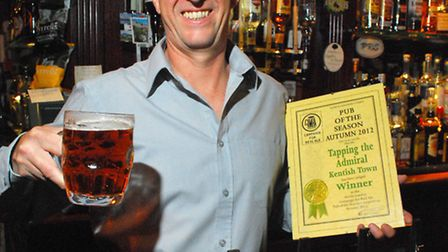 Spike Williams, manager of Tapping The Admiral, with their CAMRA Award for Pub of The Season Autumn