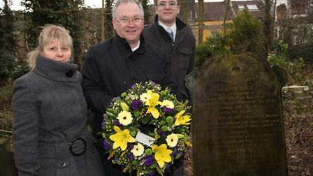 Geoffrey Cole, centre, with his wife Jill and son Tim, finally pay respect to Geoffrey's grand-uncle