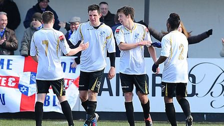 Wingate's Hector Mackie (second from left) celebrates his opening goal against Hendon