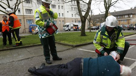 Paramedics treat 'casualty' Mike Fraser during Exercise Dragon, a joint operation in emergency respo