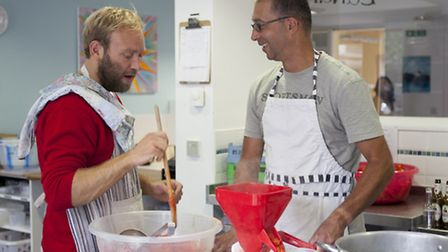Joseph Trivelli (left) with Headway member and trainee cook.