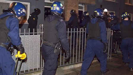 Officers raid the homes of suspected drug dealers in Hoxton during Operation Haka. Photo Gary Manhin