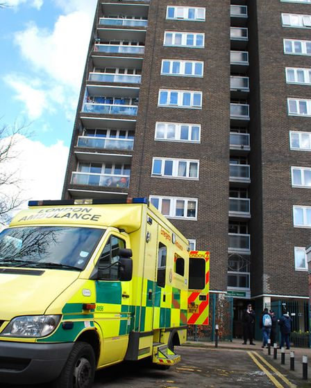 Paramedics on scene after a man threatened to jump from Palgrave House flats in Hampstead. Picture: