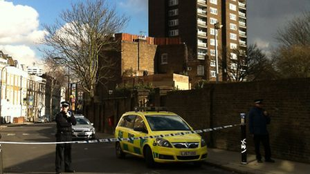The man is hanging from a fourth floor window of Palgrave House flats in Hampstead