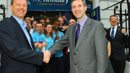 Phil Rumbelow, chief executive of Jubilee Halls Trust, shakes hands with Chris Burghes, chief execut