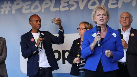 MP Chuka Umunna films on his mobile phone as MP Anna Soubry addresses Anti-Brexit campaigners at a r