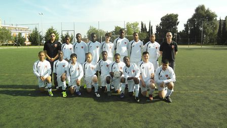 Peter Blackwell (back left) and his team from ReachOut FC.