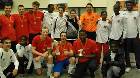 Cup Champions, Bloomberg, with tournament organisers from the ReachOut! Academy project.