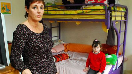 Katerina Spencer, with her children Nicolas, 15, and Grace, 5, in their one room at the hostel in En