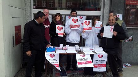 Signatures are collected on a petition outside Swiss Cottage Post Office during a strike in April