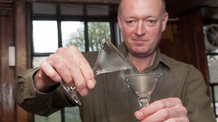 Ian Hart of Sacred Spirits mixes gin at a tasting event at the Spaniards Inn in Hampstead