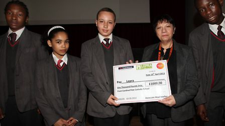 Cardinale Pole students Giovanni, left, Jeanice, Kayne and Hayden give a £1000,00 cheque to Sue Davi