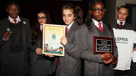 Cardinale Pole schoolgirls Chelsie, left, Elif, Helin, Lloyda, and Jeanice receive some gifts for th