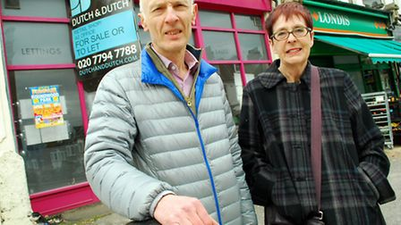 Mark Hutton and Virginia Berridge outside one of the empty shops in Mill Lane in West Hampstead