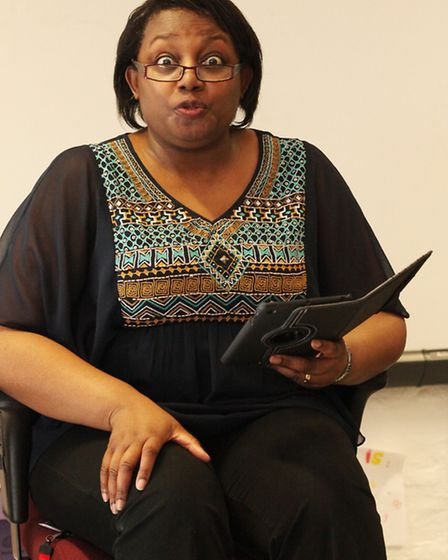 Author Malorie Blackman reads a piece from one of her books to Year 6 children at De Beauvoir School