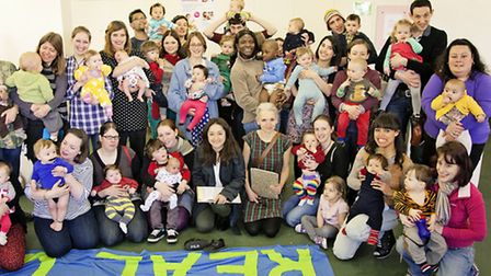 Topped and tailed... mums on way to world record-breaking nappy change