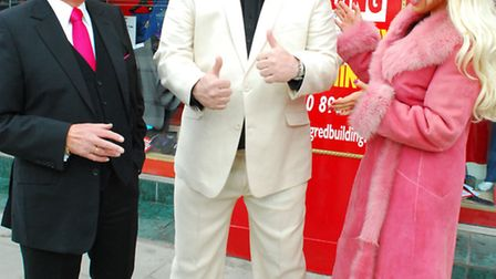 Neil Ruddock outside Gold's Factory Outlet with owner Warren Gold and fiance Leah Newman. Picture: P
