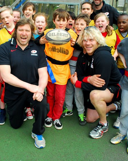 Saracens players Carlos Nieto (left) and Mouritz Botha with Highgate Primary School pupils. Picture: