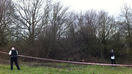 Police officers at the scene after a body was found in bushes on Hampstead Heath