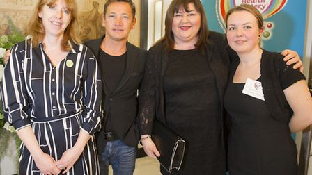Hackney Playbus staff members Jane Lavelle (left) and Sarah Wilson (right) pose with Eastenders star