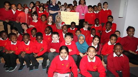 Nurses Marianne Hill, left, and Syreeta Gibbons receive a £400 cheque from Daubeney Schoolchildren t