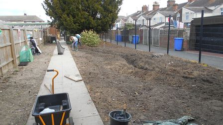 Work to transform a piece of waste ground into a new sensory garden. Picture: Rainbow Day Nursery.