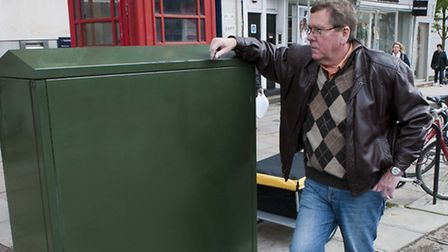 Cllr Chris Knight with the BT Broadband box that was installed in Hampstead High Street without prio