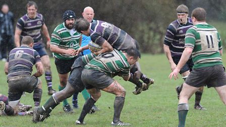 Belsize Park's scrum-half Ben Parker is tackled by Hendon's Tommy Middleton, who scored two tries, a